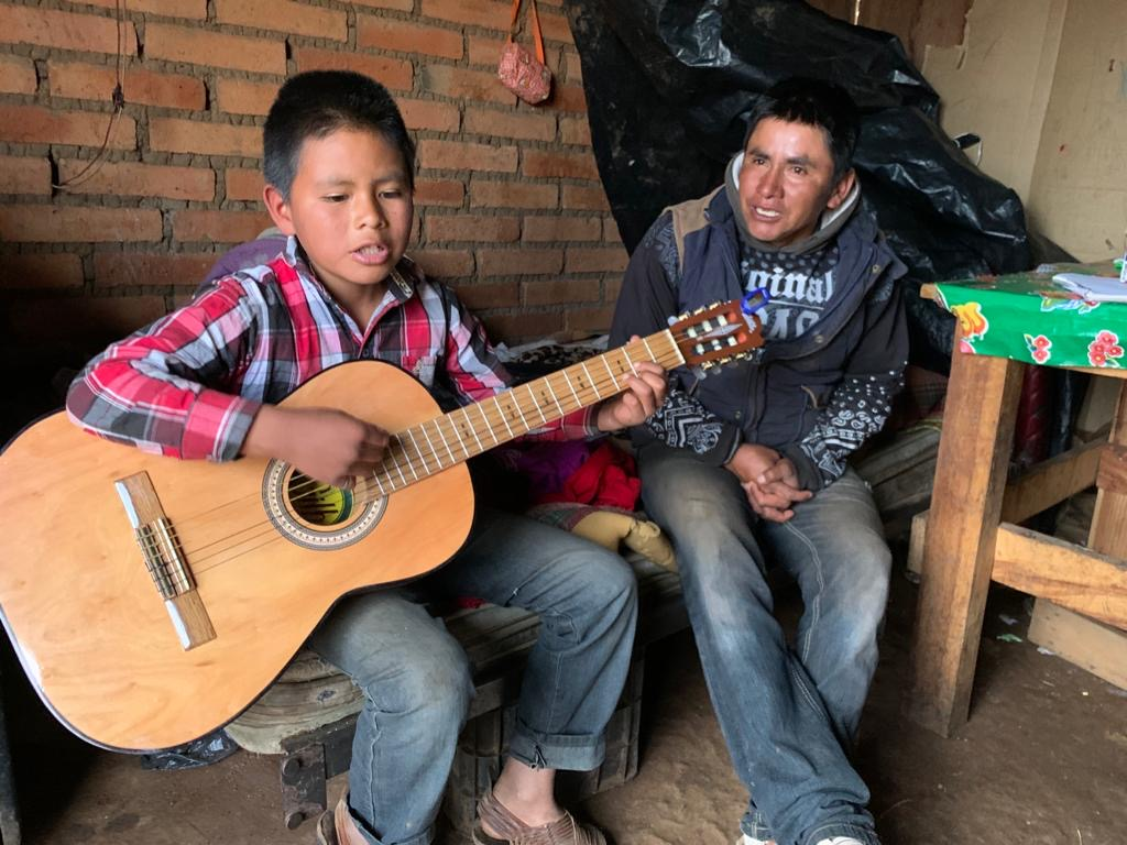 cora boy playing guitar
