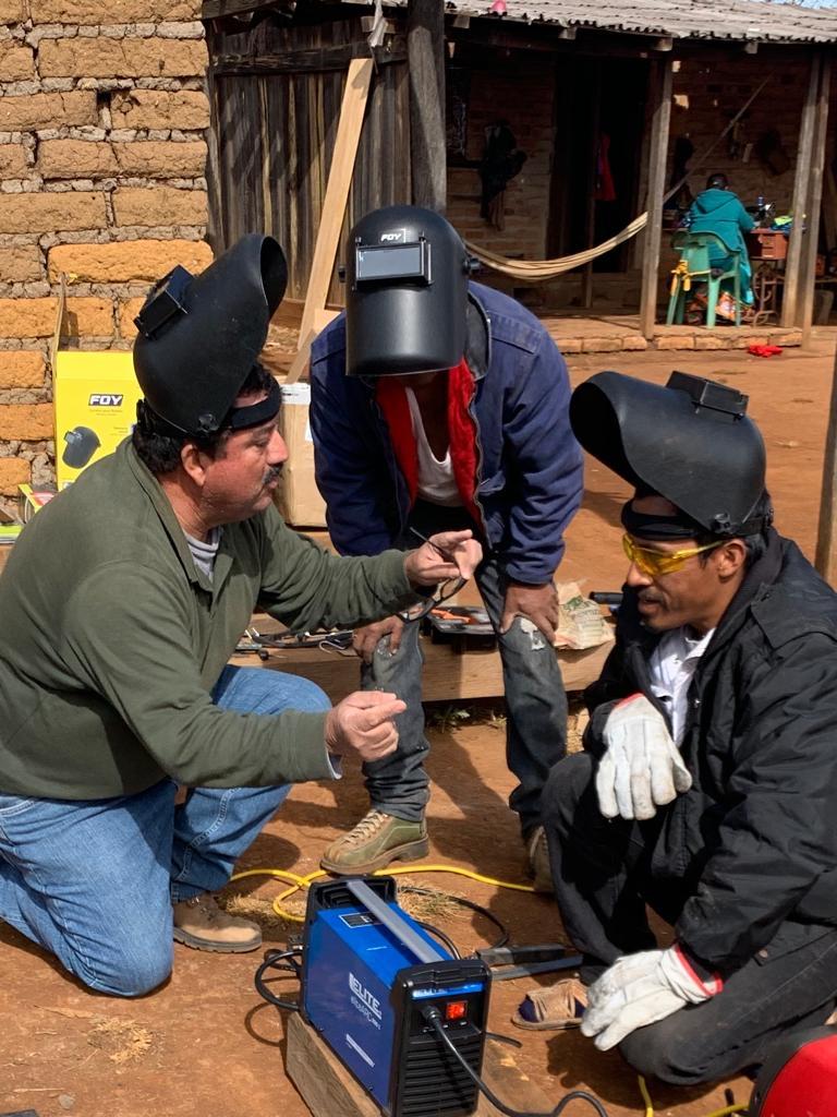 chuy teaching welding class to cora man
